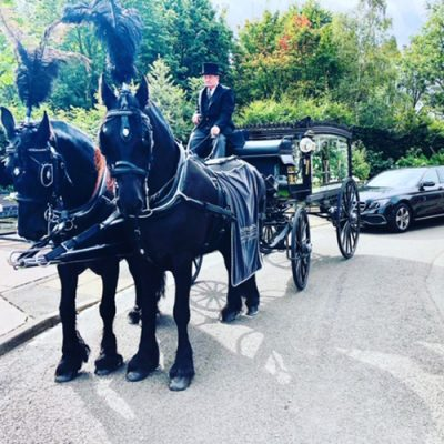 Our Horse-drawn funeral Carriage with two black horses