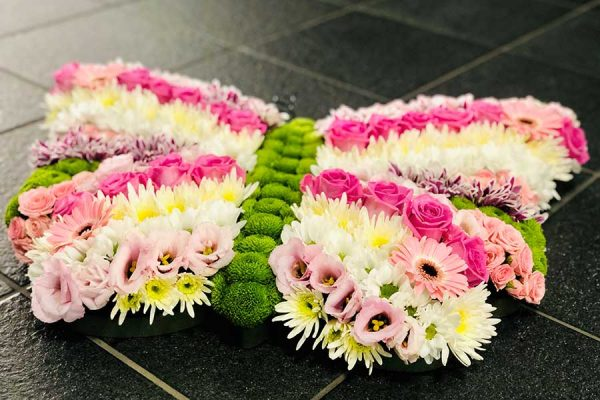 Colourful butterfly floral tribute for a funeral.