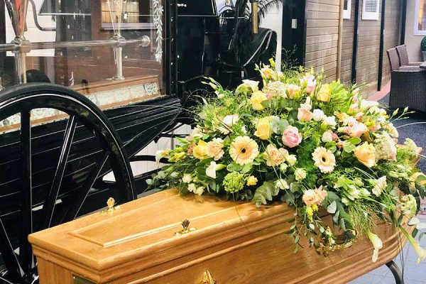 Funeral floral tribute on a coffin at Hopkinson
