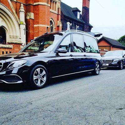 Hopkinson funeral cars outside the Sacred Heart Church Hanley