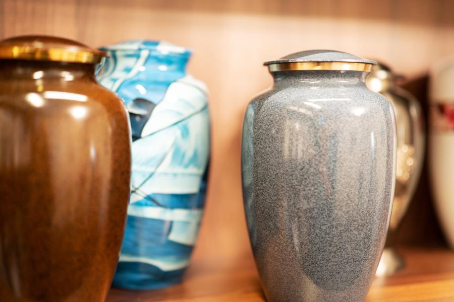 Urns on a display shelf at Hopkinson Wootton Lovatt